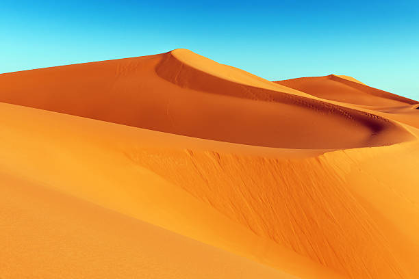 erg chebbi sand dune at sunrise, morocco, africa - sand dune stock photos and pictures