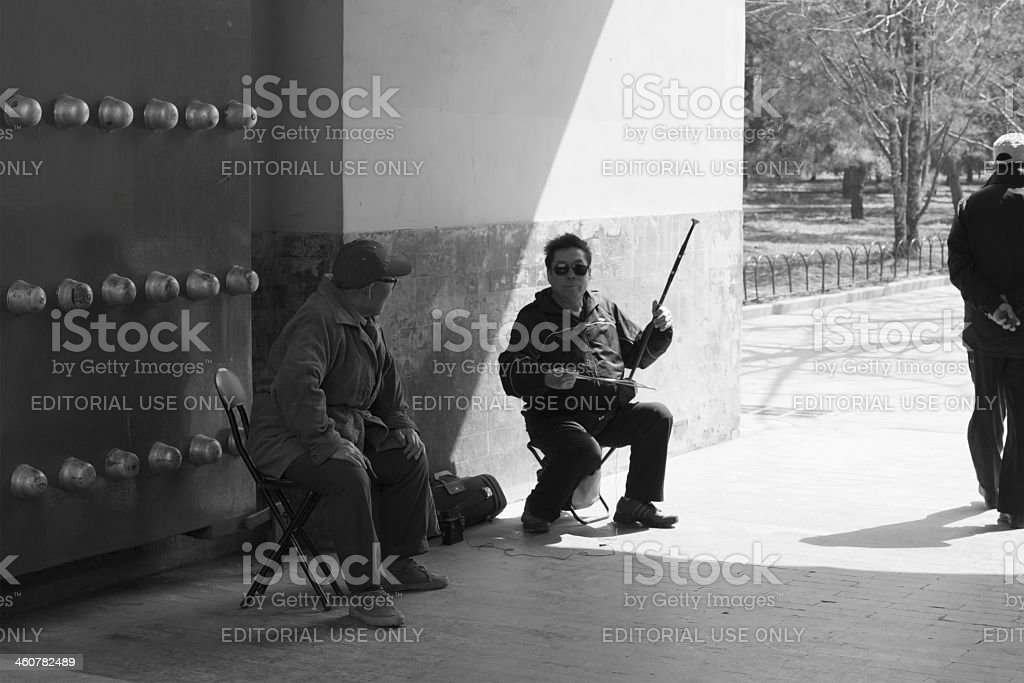 Erhu Chinese violin player in Temple of Heaven Park, Beijing stock photo
