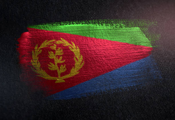 eritrea flag made of metallic brush paint on grunge dark wall - eritrea stock photos and pictures