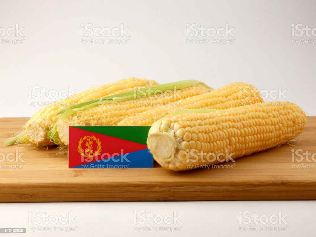 Eritrean flag on a wooden panel with corn isolated on a white background stock photo