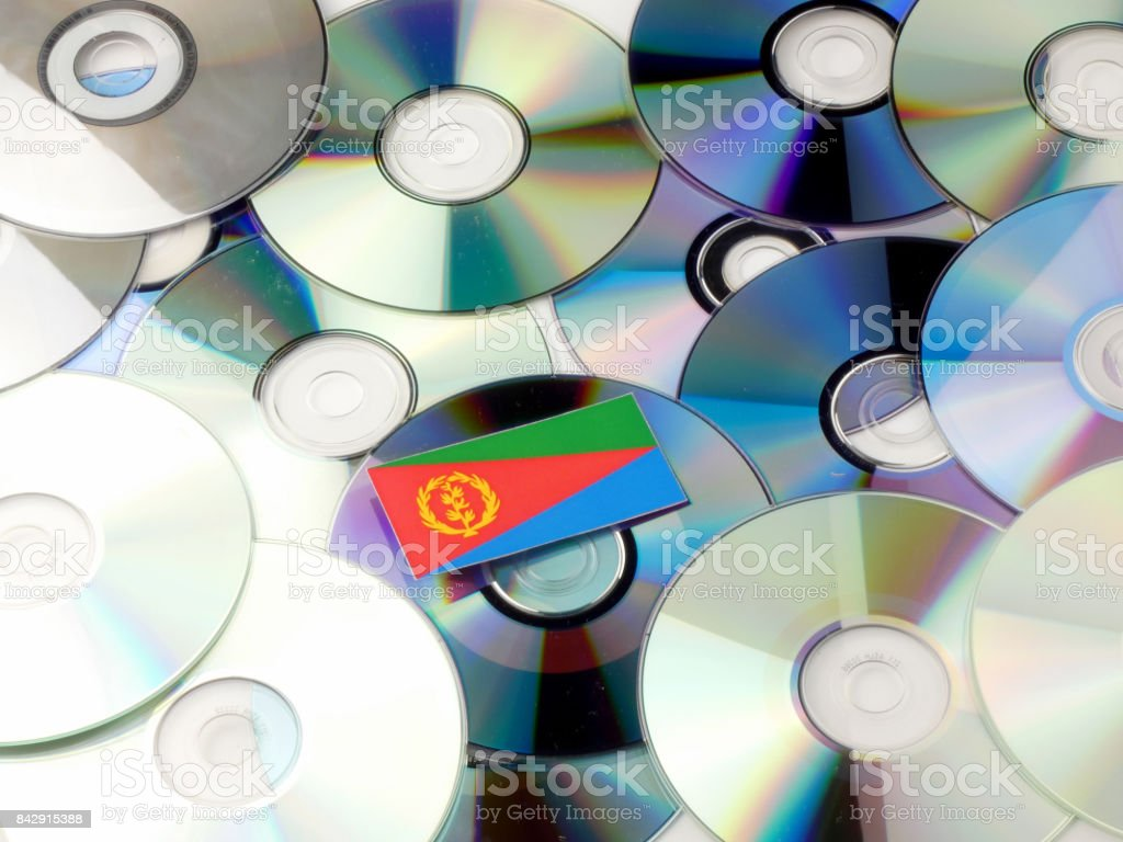 Eritrean flag on top of CD and DVD pile isolated on white stock photo