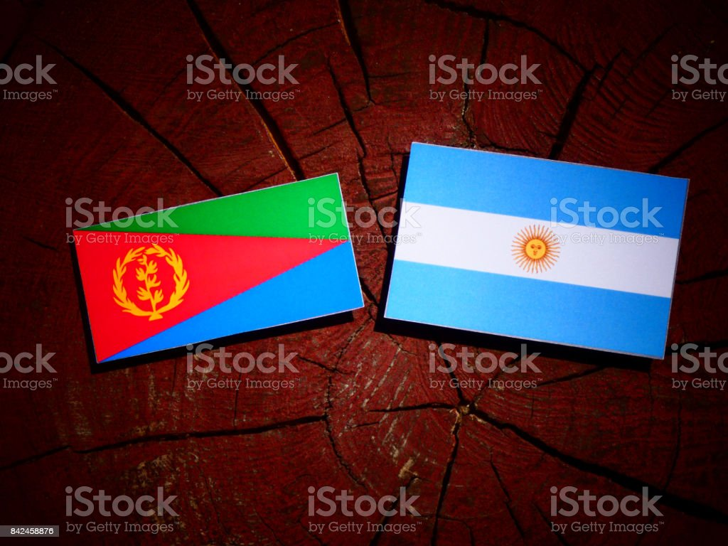 Eritrean flag with Argentinian flag on a tree stump isolated stock photo
