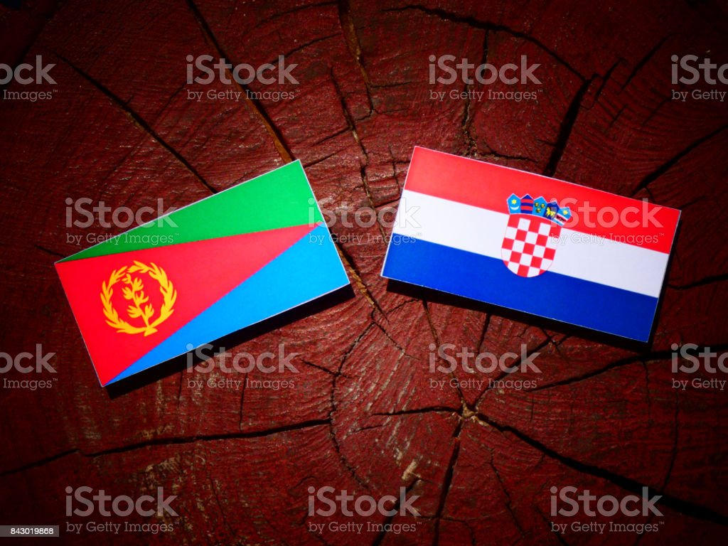 Eritrean flag with Croatian flag on a tree stump isolated stock photo