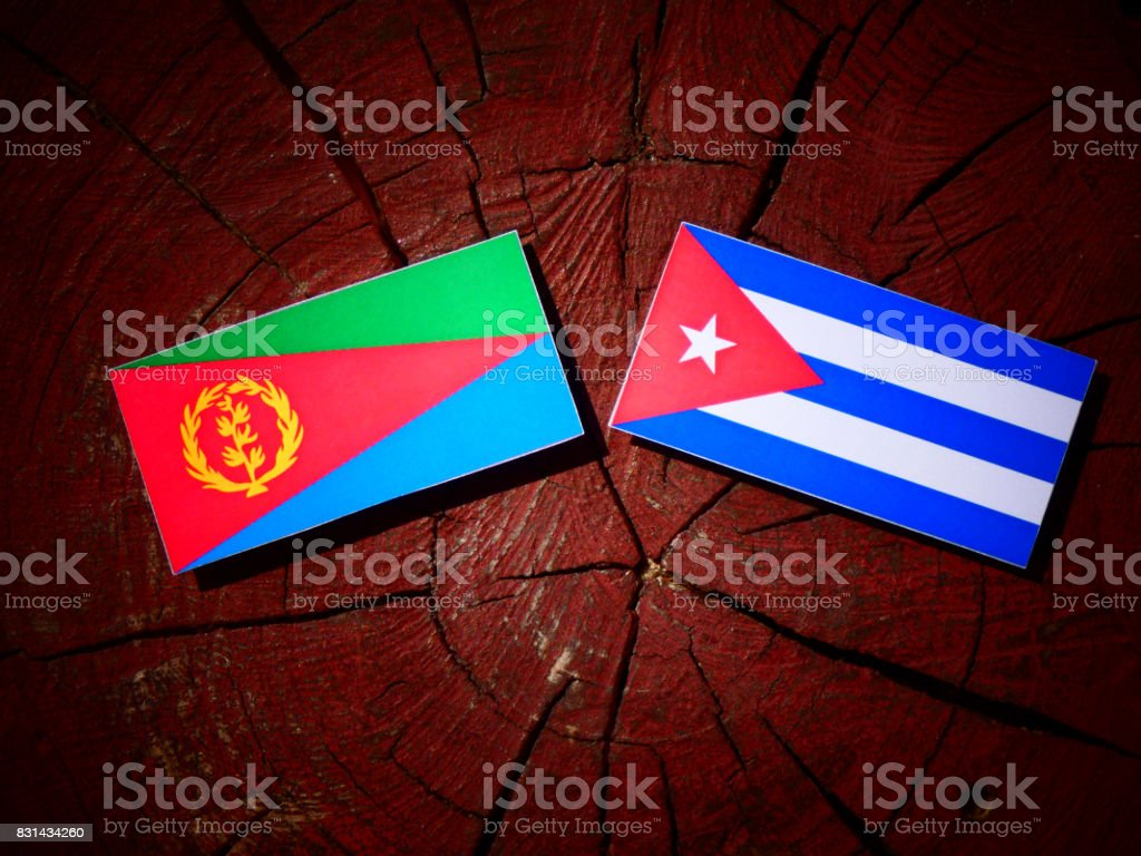 Eritrean flag with Cuban flag on a tree stump isolated stock photo