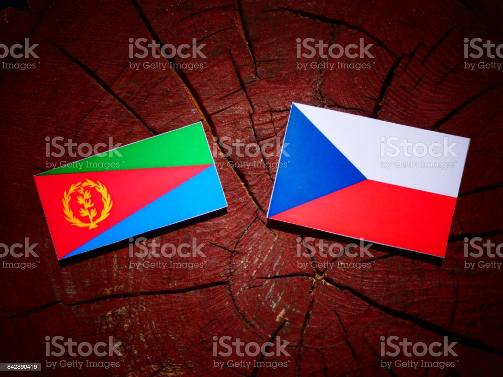 Eritrean flag with Czech flag on a tree stump isolated stock photo