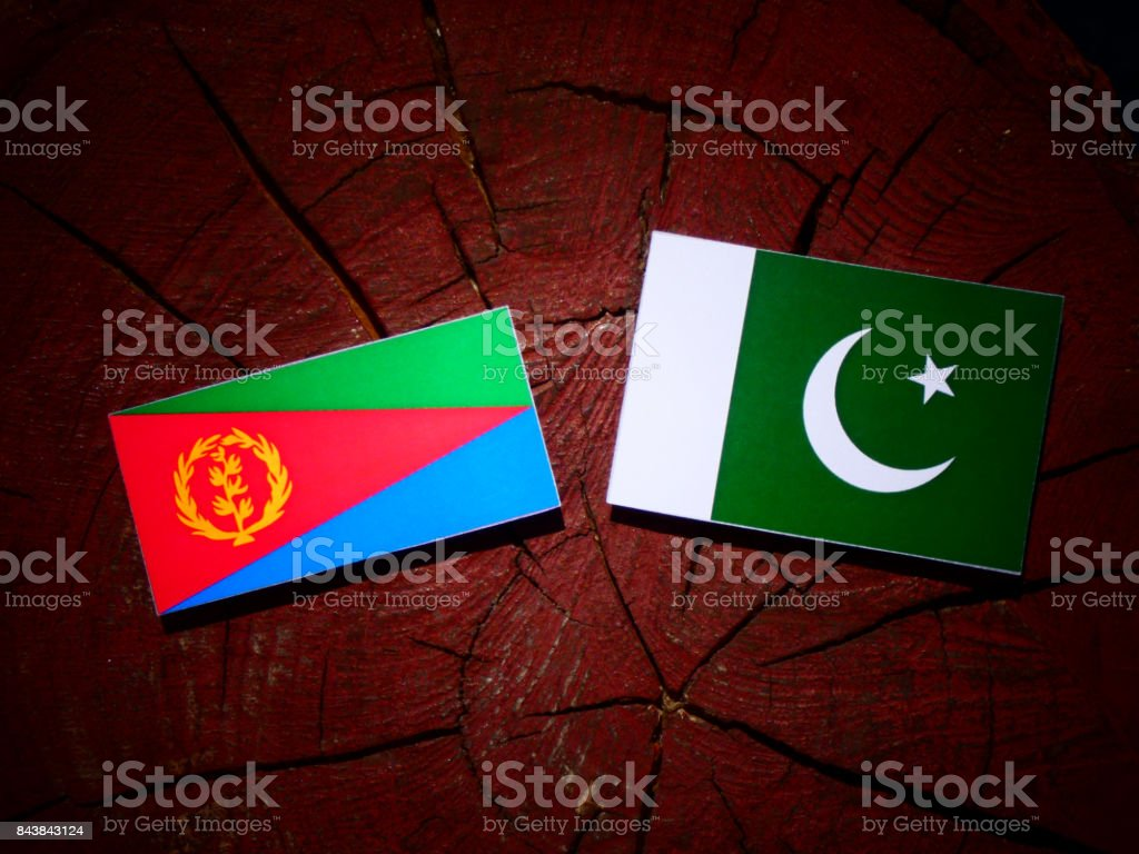 Eritrean flag with Pakistan flag on a tree stump isolated stock photo