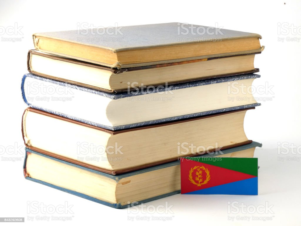 Eritrean flag with pile of books isolated on white background stock photo