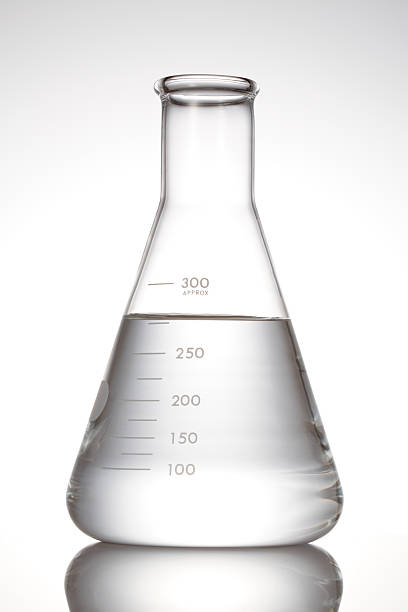 Erlenmeyer flask with clear liquid lab Flask on white background dry measure stock pictures, royalty-free photos & images