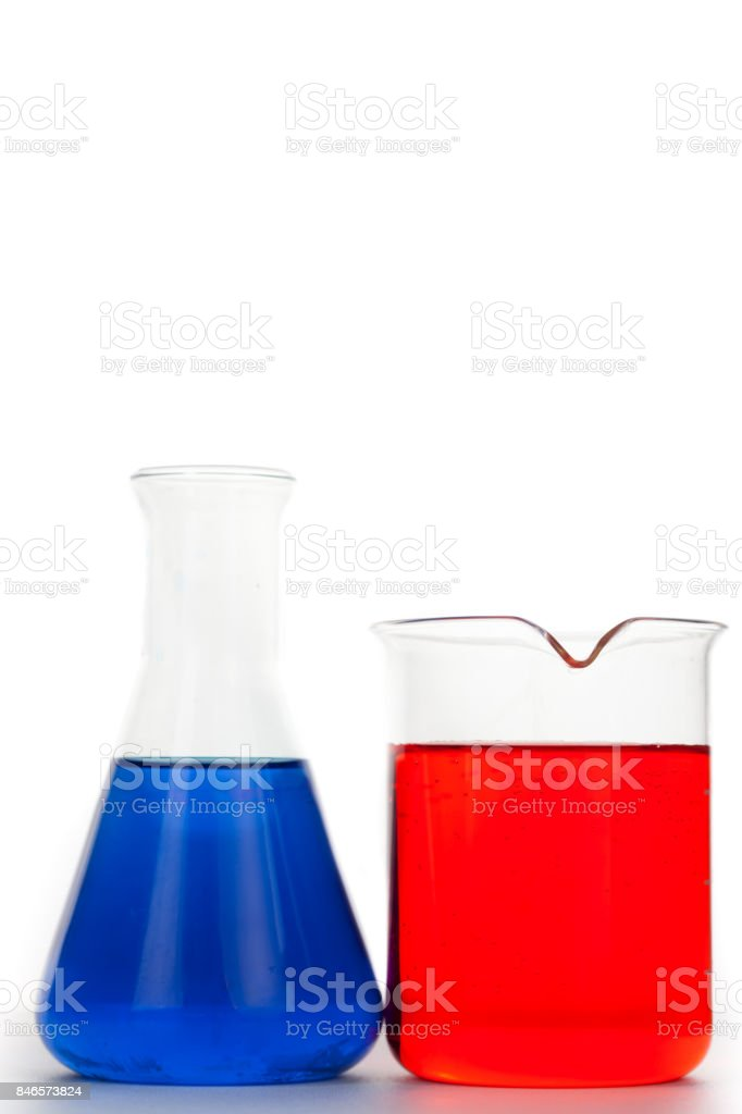 Erlenmeyer next to a beaker stock photo