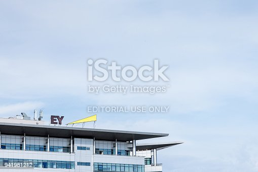 istock Ernst and Young (EY) logo on their main office for Serbia. EY is one of the leading companies in Business Services, audit, tax advice and accounting 941981212