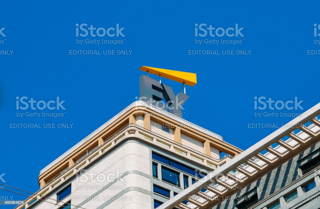 Ernst and Young sign on modern building facade Milan, Italy - April 19th, 2018: Ernst and Young sign on modern building facade Accountancy Stock Photo