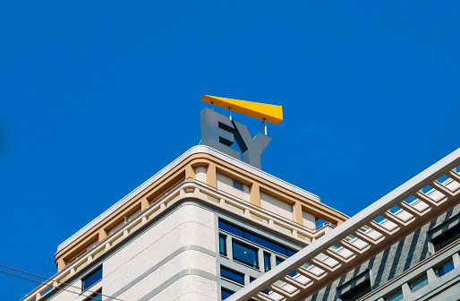 Ernst And Young Sign On Modern Building Facade Stock Photo - Download Image Now