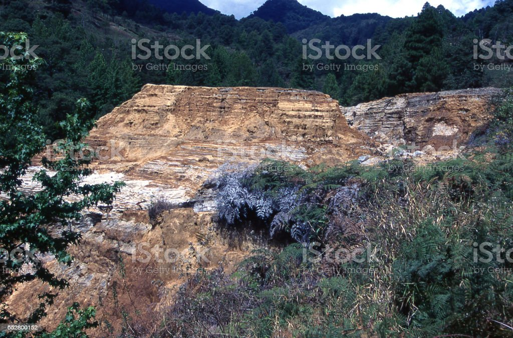 Eroded ancient mine tailings from gold mining work in the 19th...