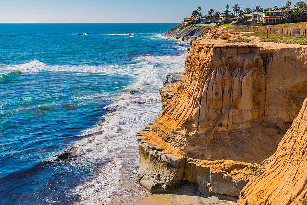 Eroded cliff of Carlsbad with breaking surf, CA Rugged coastline of Southern California with breaking surf at Carlsbad, California eroded stock pictures, royalty-free photos & images
