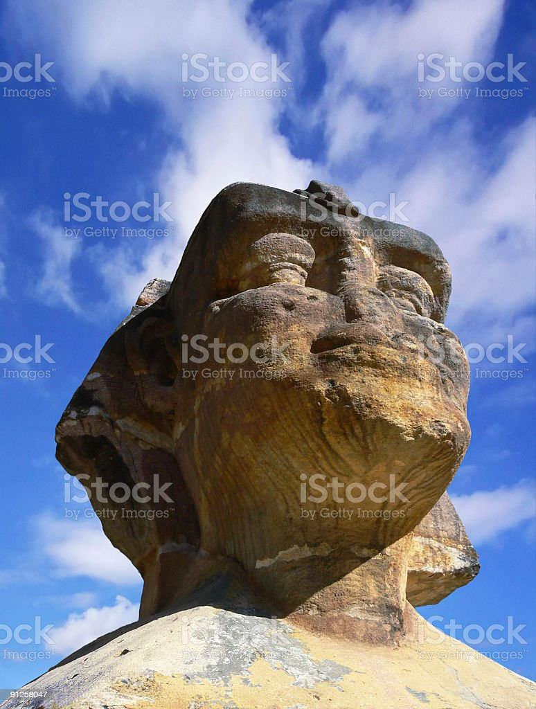 Eroded Egyptian Sphinx head with sweeping clouds royalty-free stock photo