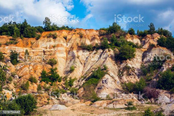 Photo of Eroded limestone rock face with landslides