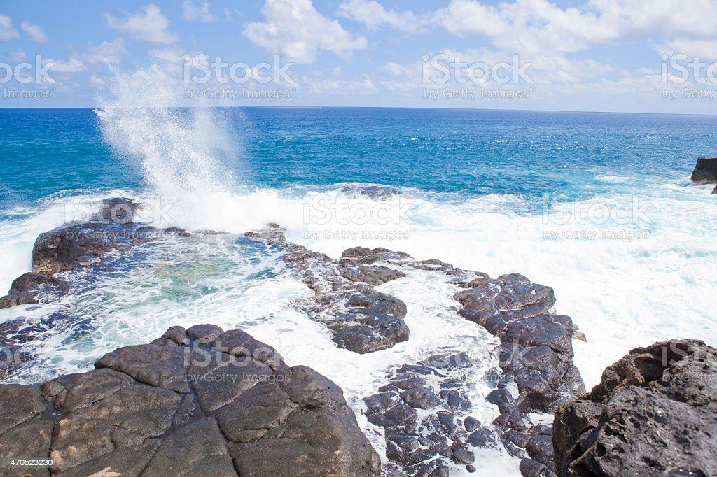 Eroded rocky volcanic coast stock photo