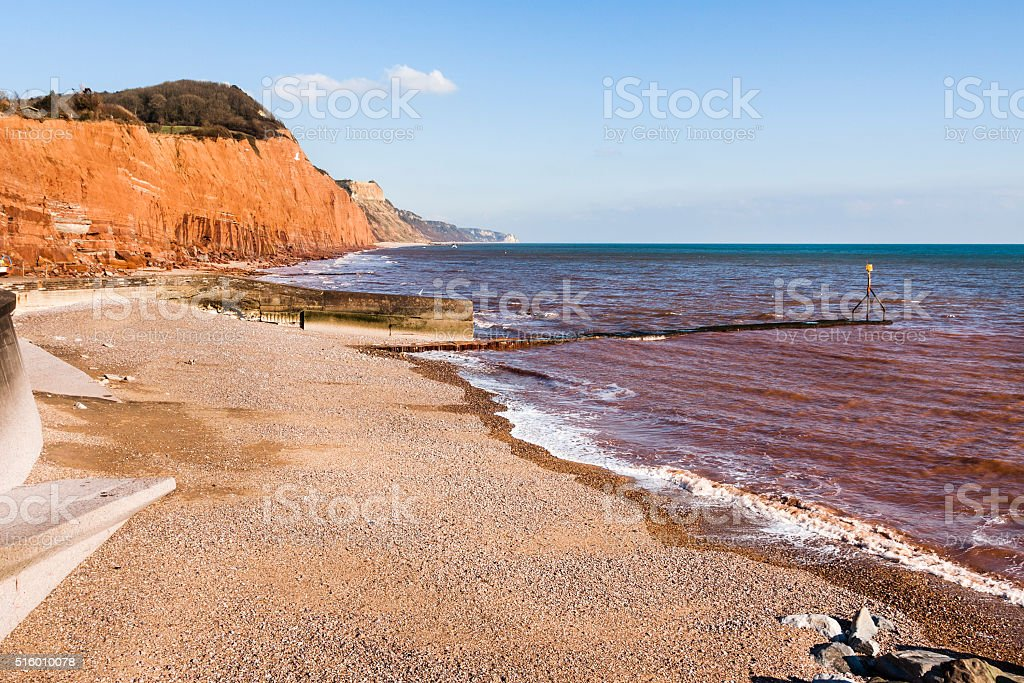 Eroded sandstone cliffs and beach at Sidmouth, Devon, England stock photo