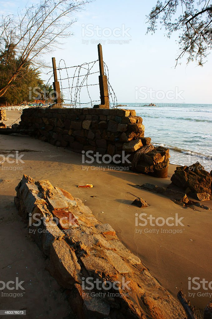 Erosion, wave destroy seawall, effect of climate change stock photo