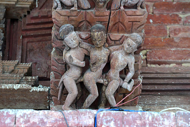 erotic carvings on a hindu temple in kathmandu, nepal - naked women with animals stock photos and pictures