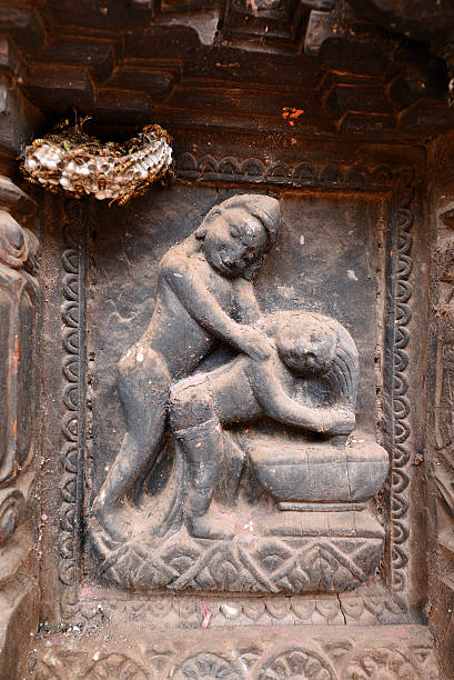 erotic carvings on hindu temples in kathmandu, nepal - naked women with animals stock photos and pictures