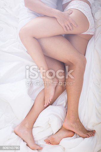 istock Erotic close embrace in bed 509243790