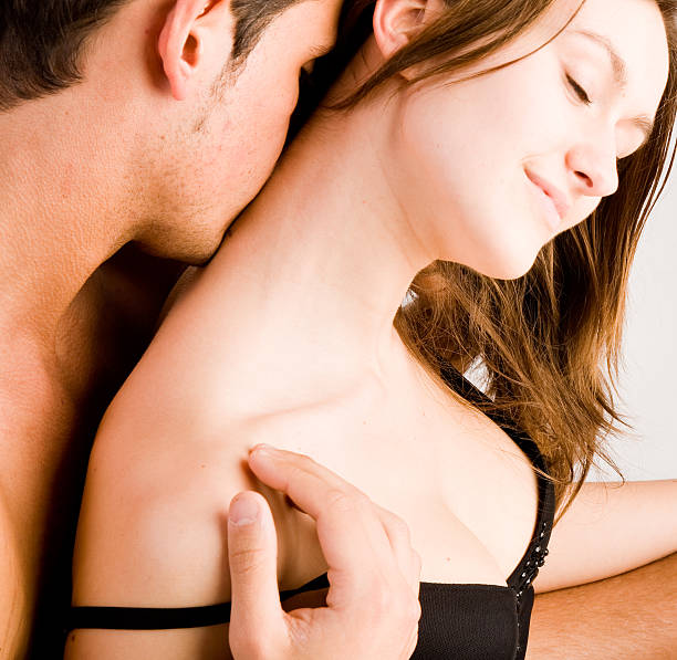 erotic couple - kissing on neck stock photos and pictures