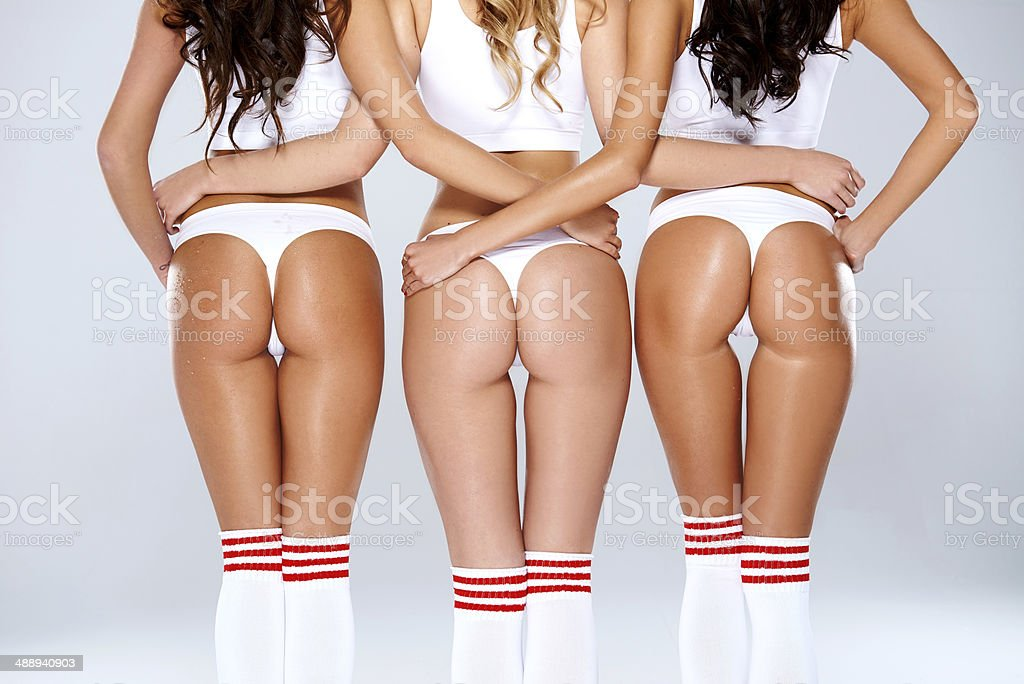 Erotic display of shapely toned female buttocks stock photo