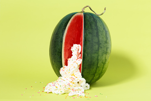 Erotic Fruit Watermelon With Whipped Cream And Colourful Sprinkles Stock Photo - Download Image Now
