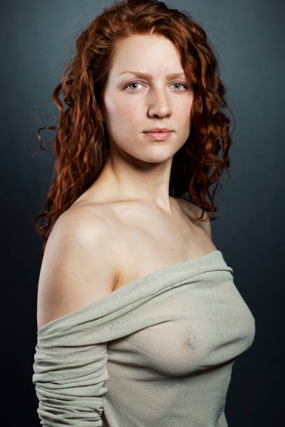 erotic red hair woman indoor portrait - woman green eyes red hair stock photos and pictures