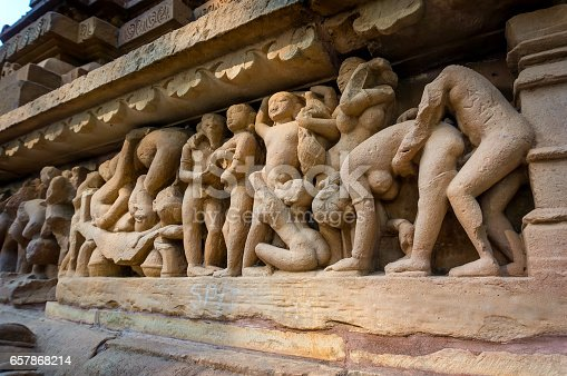 istock Erotic scene on sculptured surface of famous indian temple of Khajuraho. 657868214