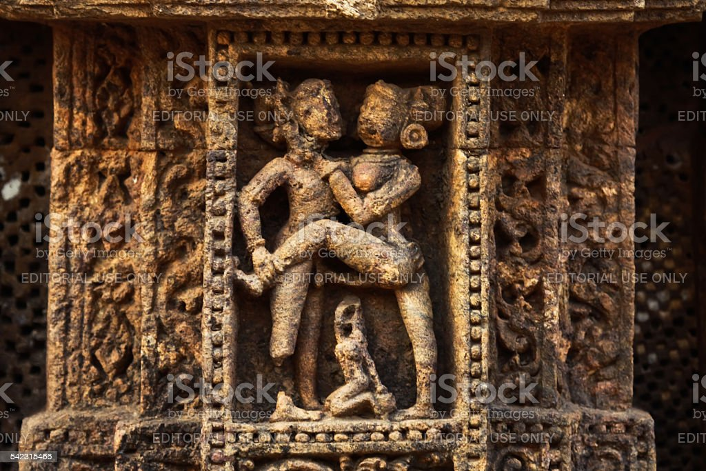Erotic sculpture on temple wall stock photo