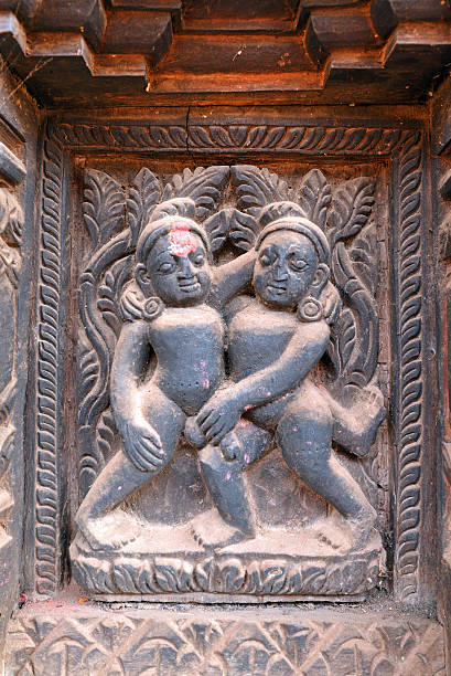 erotic wooden carving motif on a hindu temple in nepal - naked women with animals stock photos and pictures