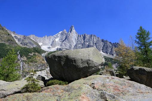 Erratic block. The Drus (3754 m). The little Dru (3,730 m) and the big Dru (3,754 m). Massive Mont Blanc. Montenvers. Chamonix. Haute-Savoie. France.
