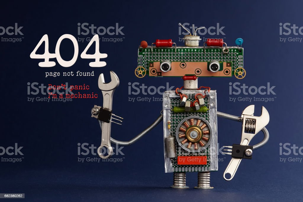 404 error page not found concept. Don't panic I'm a mechanic. Hand wrench adjustable spanner robot handyman on dark blue paper background. Cute robotic toy made of electronic circuits, chip capacitors stock photo