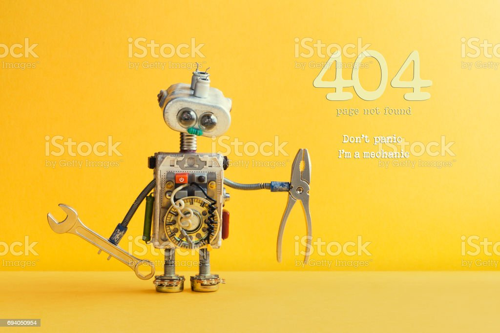 404 error page not found concept. Don't panic I'm a mechanic. Hand wrench pliers robot handyman on yellow background. Cyborg toy lamp bulb eyes head, electric wires, capacitors vintage resistors stock photo