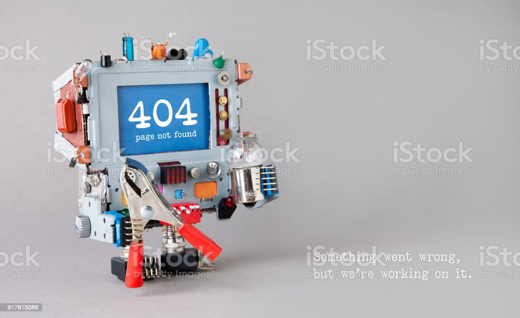 404 error page not found. Handyman robot with red pliers light bulb on gray background. Text message Something went wrong but we are working on it stock photo