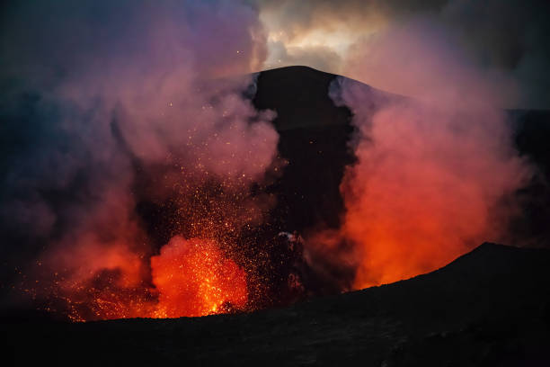 Erupting Mount Yasur Volcano Tanna Island Vanuatu Lava Crater Erupting Volcano Mount Yasur at Night, view towards the erupting volcano crater of the active Mount Yasur Volcano, Tanna Island, Vanuatu, Melanesia, South Pacific vanuatu stock pictures, royalty-free photos & images