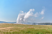 Eruption of Old Failthful Geyser at Yellowstone National Park