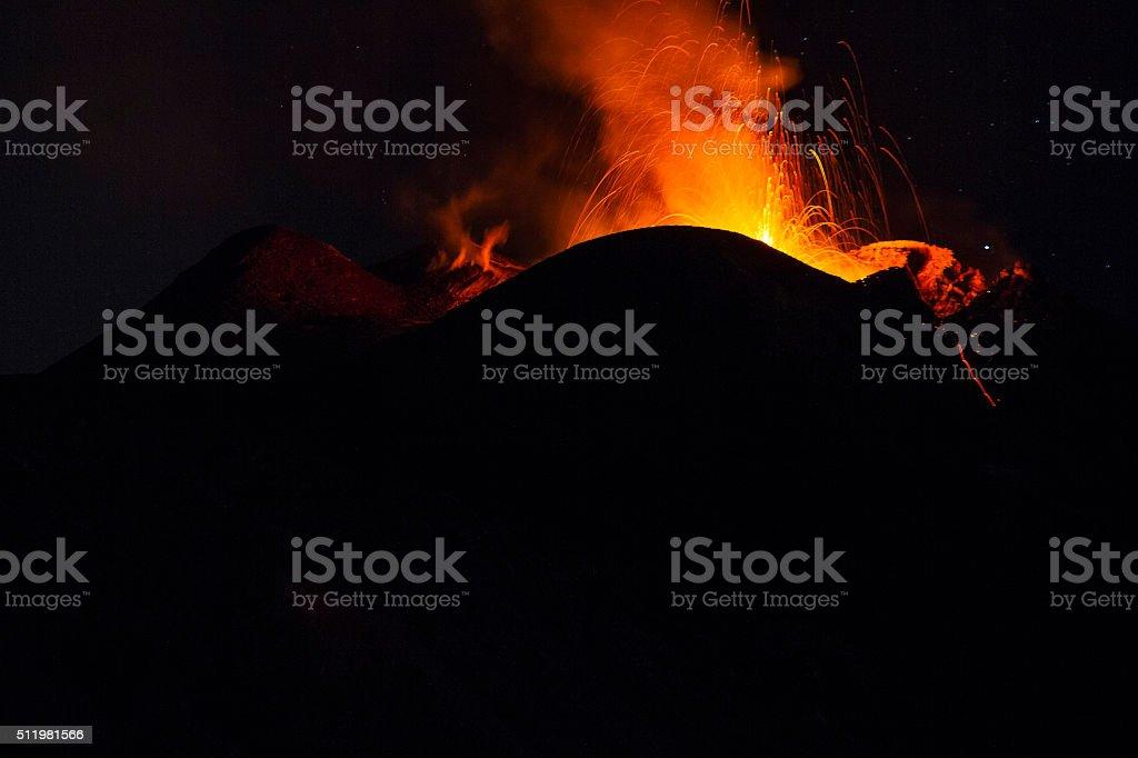 eruptive activity at night stock photo