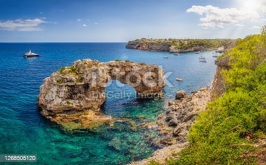 istock Es Pontas / Es Pontàs a natural arch near Cala Llombards on the Spanish Balearic island of Majorca - Spain 1268505120
