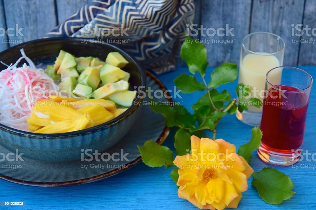 Es Teler, fruit cocktail from Indonesia. Avocado, coconut meat and jackfruit served with coconut milk, sweetened condensed milk and syrup - Royalty-free Avocado Stock Photo