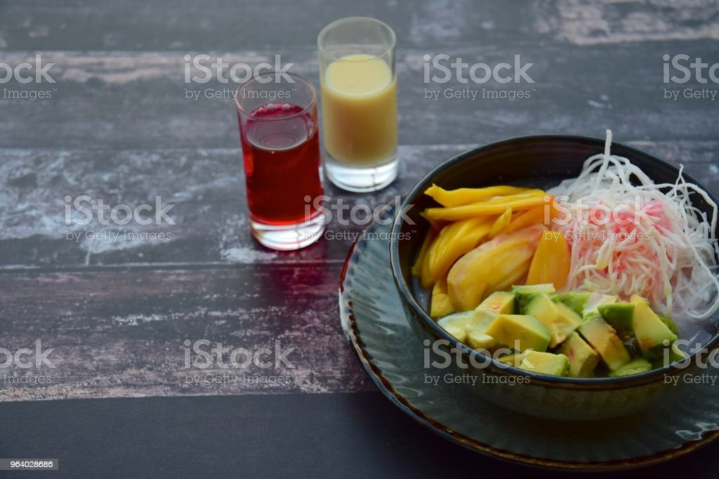 Es Teler is a fruit cocktail from Indonesia. Avocado, coconut meat and jackfruit served with coconut milk, sweetened condensed milk and syrup - Royalty-free Avocado Stock Photo
