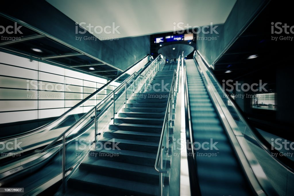 Escalator and Stairs in Building royalty-free stock photo