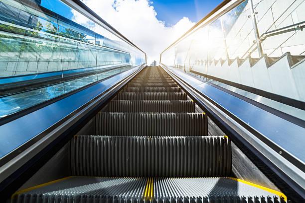 escalator in an underground station - escalator foto e immagini stock