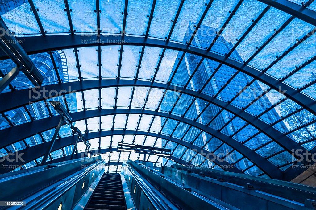 Escalator in subway station at Canary Wharf, London stock photo