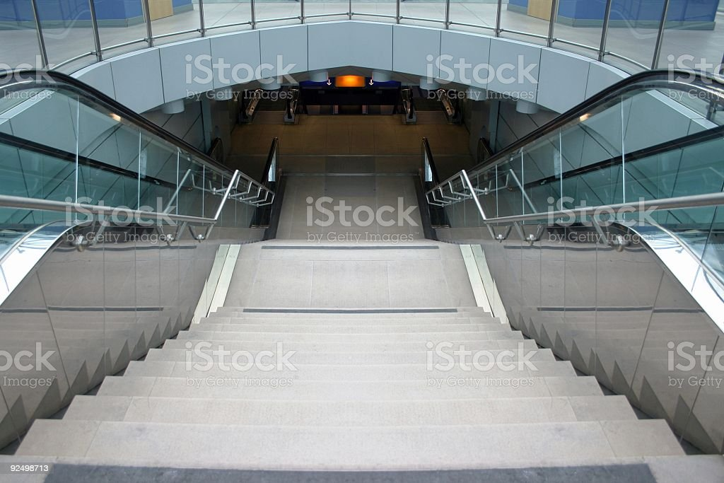 Escalator in subway station, symmetric royalty-free stock photo
