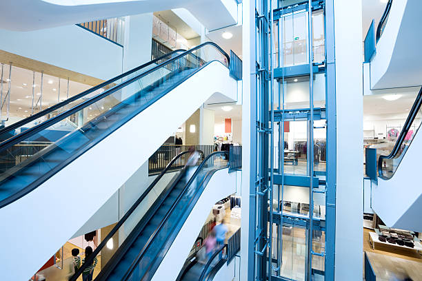 Escalators and elevator in shopping center stock photo