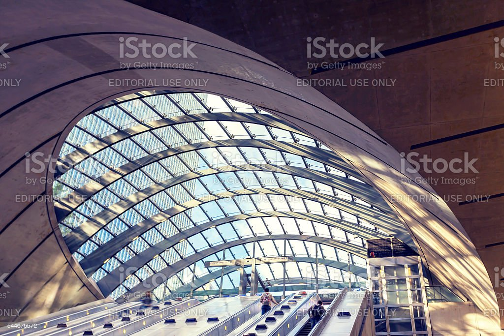 Escalators and roof light Canary Wharf underground station in London stock photo