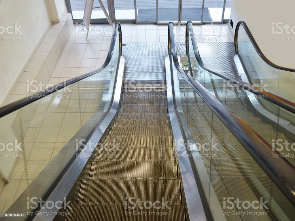 Escalators from the ground floor to the second one inside a supermarket